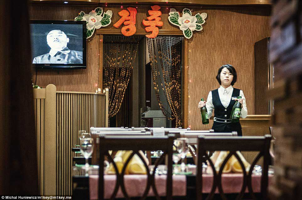 A waitress works in a restaurant at Pyongyang