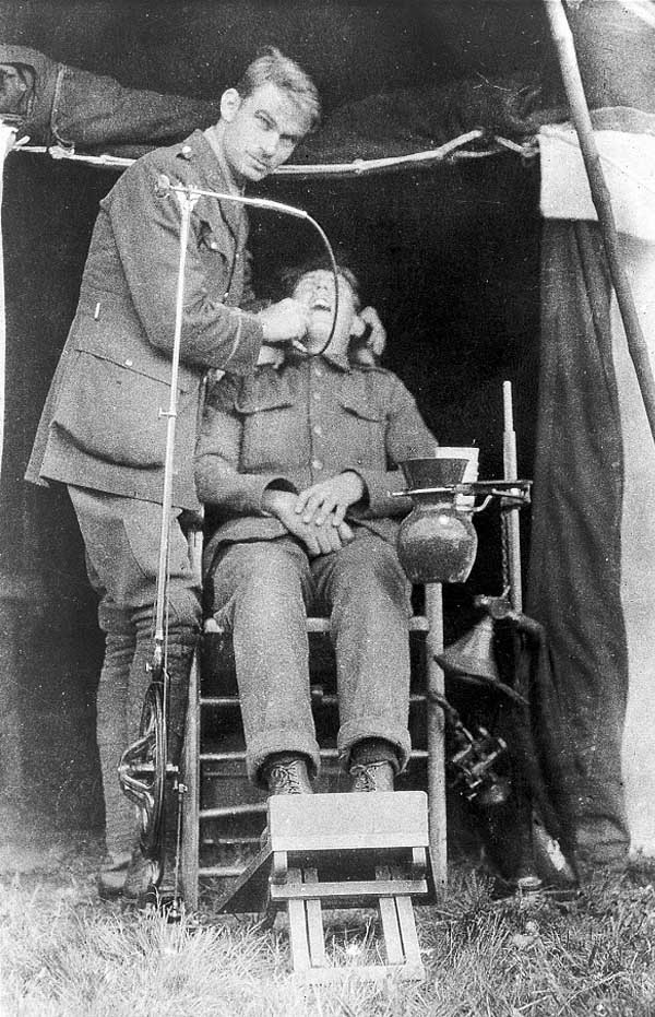A field dentist at work during World War I. 1915.