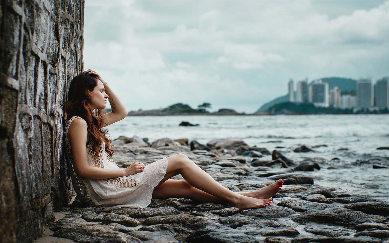 You feel the need to be alone but you'll need to avoid it. alone, woman, sad, city, water, lake
