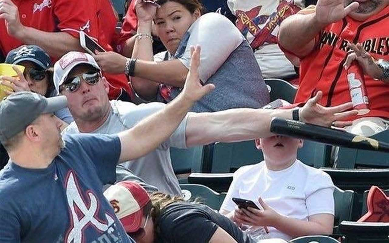 A flying bat, oblivious child and dad reflex