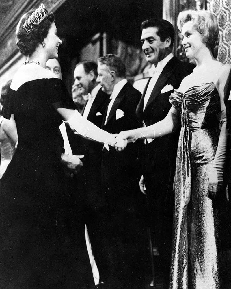 Queen Elizabeth and Marilyn Monroe were both born in the same year. Here,(both 30 at the time) meet at a movie premier in London, October, 1956.