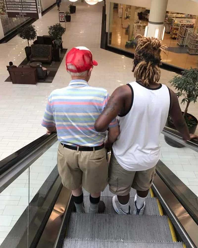 young man, old man, escalator, helping, kindness, life