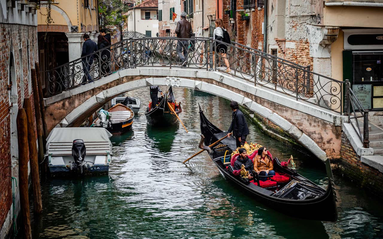 Venice, Italy, riding bikes, facts, people, tourists, swimwear, eating