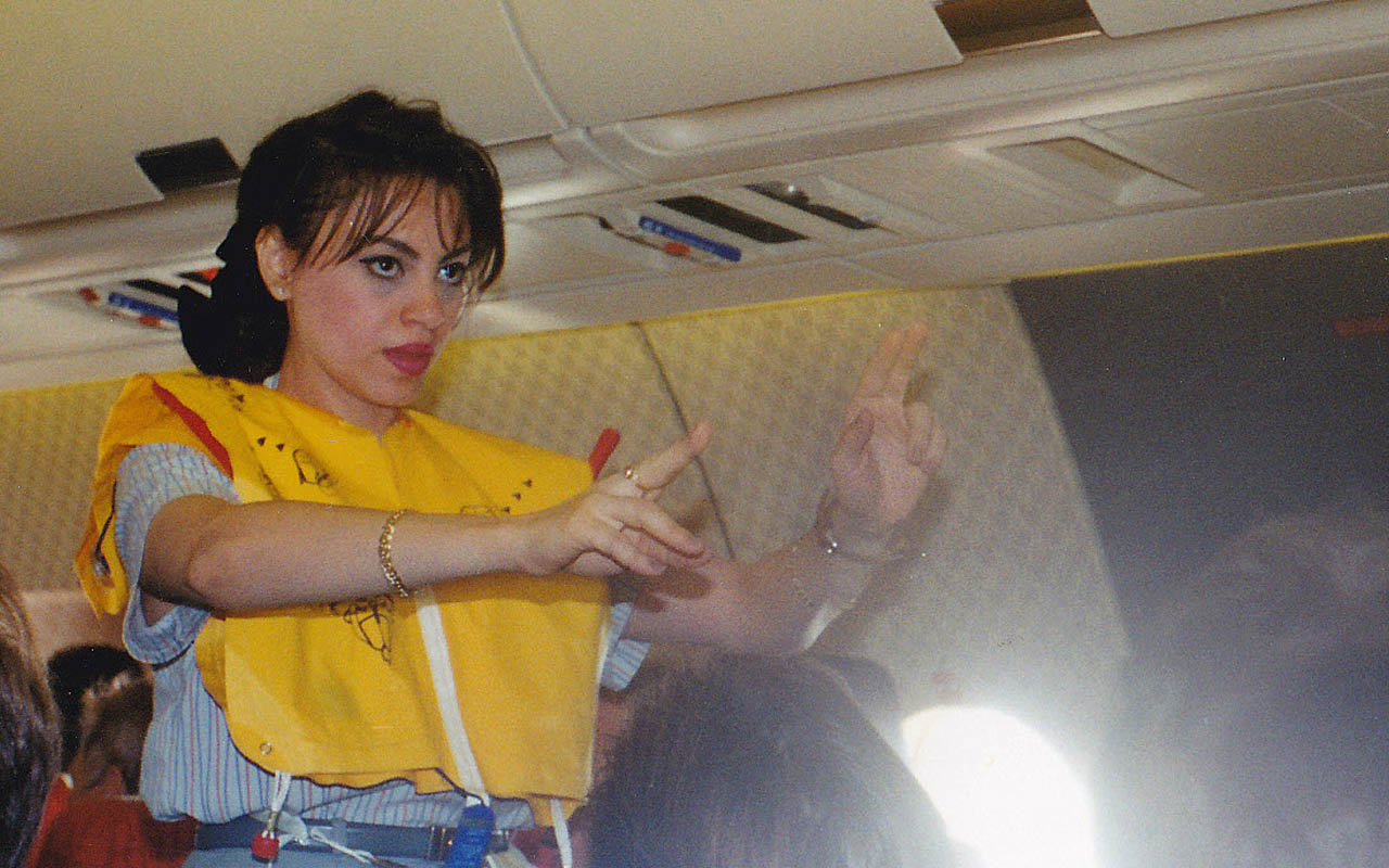 air hostess, airplane, life jacket, facts, inflate, cabin, emergency